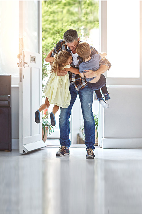 Father and Kids Feeling protected by Home Alarm System